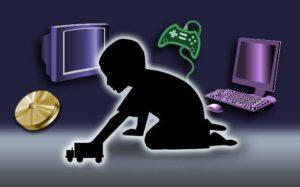 childshadowwithlaptopphonegamecontrollermore